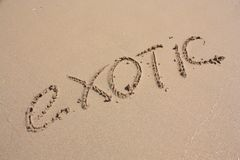 Word EXOTIC on the beach Royalty Free Stock Photo