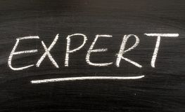 The word EXPERT on a blackboard Stock Images