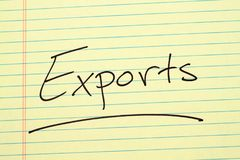 Exports On A Yellow Legal Pad Stock Photos