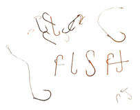 Word F I S H and old rusty fish hooks Stock Photos