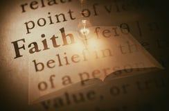 Word faith and light bulb Stock Photos