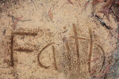 Faith written in sand Stock Image
