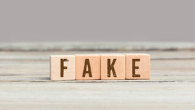 Word Fake on wood cubes Royalty Free Stock Images