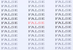 Word False among similar text. The word 'False' in red type among similar black text Royalty Free Stock Images