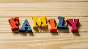 The word family out of colored wooden letters on the table. Photo Royalty Free Stock Photos