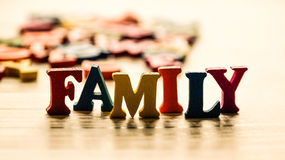 The word family out of colored wooden letters on the table. Photo Stock Photo