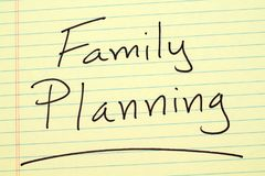 Family planning on a yellow legal pad Royalty Free Stock Image