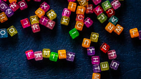 Word family square lined with colored letters. Photo Royalty Free Stock Images