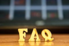 The word `faq` made of wooden letters royalty free stock photography