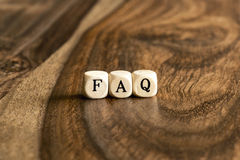 Word FAQ on wooden cubes Royalty Free Stock Image