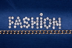 Word FASHION made by with rhinestones and gold chain Royalty Free Stock Image