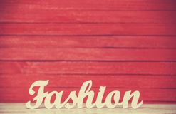 Word Fashion. Wooden word Fashion on red background Stock Images