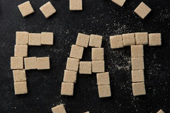 The word fat made of sugar cubes. On table Stock Photo