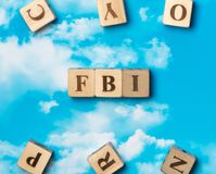 The word FBI. On the sky background Royalty Free Stock Photos