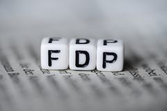 Word FDP formed by wood alphabet blocks on newspaper german party politics. Closeup Stock Image