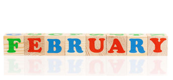 Word february. With colorful blocks isolated on a white background royalty free stock photos
