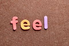 The word feel. On a brown background Stock Images