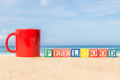 Word FEELGOOD in colorful alphabet blocks on tropical beach Royalty Free Stock Images
