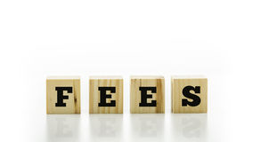 The word - Fees - on wooden blocks or cubes Royalty Free Stock Photo