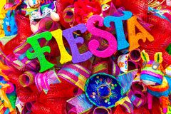 The word `fiesta` written in colorful foam letters on multicolored mash decorated with glitter and small sombrero. Decoration for San Antonio Fiesta Festival royalty free stock image