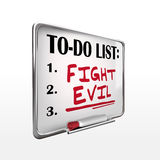 The word fight evil on to-do list whiteboard Royalty Free Stock Photography
