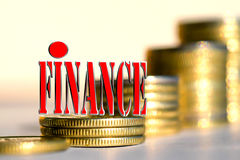 "The word "" Finance "" in the background the columns of coins . Royalty Free Stock Photo"