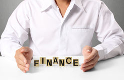 Word Finance in hand Stock Photography