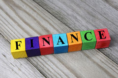Word finance on wooden cubes Stock Photos