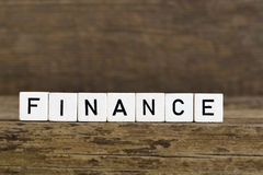 The word finance written in cubes Stock Image