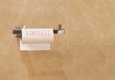 The word finished is written on a roll. Royalty Free Stock Photography