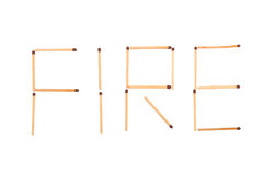The word fire made of matches. Isolated on white background Stock Photos