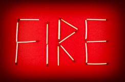 Word FIRE made of matchsticks Stock Image