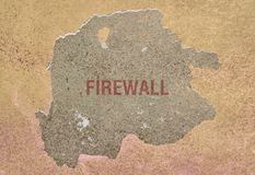 Word Firewall on a wall. Word Firewall written in red on a broken wall Stock Photography