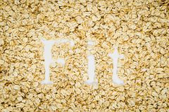 Word Fit written in oat flakes Royalty Free Stock Images