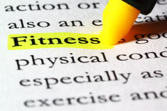 Word fitness highlighted with a yellow marker. The word fitness written on paper and highlighted with a yellow marker Stock Photo