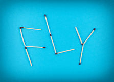 Word FLY made of matchsticks Stock Photography