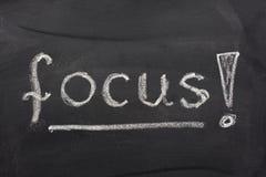 Word focus on blackboard royalty free stock image