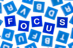 Word FOCUS in Clear Blue Letters Against Blurred Stock Photos