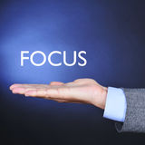 The word focus in the hand of a man Stock Photography