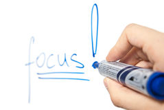 Word focus on whiteboard with focus on hand Stock Photo