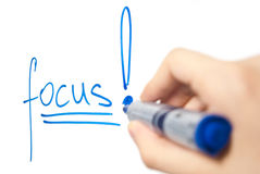Word focus on whiteboard with focus on the word Royalty Free Stock Photo