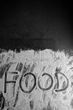 Word food written with flour on black background Royalty Free Stock Photo