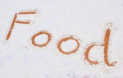 Word food written in flour Stock Photos