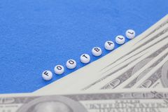 word `football` with poker chips and money royalty free stock photo