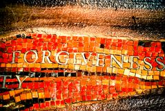 The word Forgiveness in Mosaic Tile stock photos