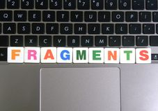 Word Fragments on keyboard background.  stock photo