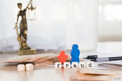 Word FRAUD composed of wooden letters. Closeup stock photo