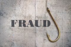 Word Fraud and a hook. Word Fraud and a fishing hook on vintage background royalty free stock images