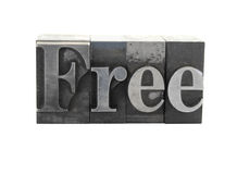 The word 'Free' in metal type. Old, inkstained metal type letters form the word 'Free' in upper and lower case royalty free stock photo