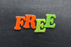 Word free spelled out using colored fridge magnets Royalty Free Stock Images